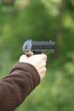 pistola a disposizione Immagini Stock