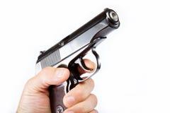 Pistola a disposizione su un bianco. Fotografia Stock
