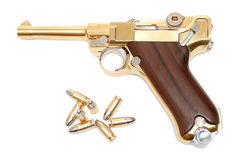 Pistola dorata Immagini Stock