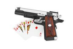 Pistola e carte da gioco Fotografia Stock