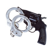 Pistola e manette Fotografia Stock Libera da Diritti