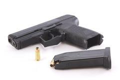 Pistola e munizioni fotografie stock