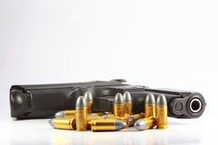 Pistola e pallottola Fotografia Stock