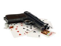 Pistola e schede Fotografia Stock Libera da Diritti