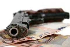 Pistola e soldi Immagini Stock Libere da Diritti