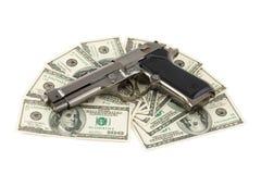 Pistola e soldi Fotografia Stock