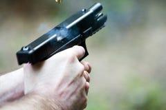 Pistola en la acción Fotos de archivo libres de regalías