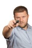Pistola minacciosa dell'uomo barbuto Fotografia Stock