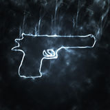 Pistola nel fumo Fotografia Stock