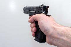 Pistola nella mano Immagini Stock