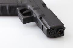 Pistola nera su priorità bassa bianca Immagine Stock Libera da Diritti