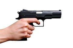 Pistola nera in una mano Fotografia Stock Libera da Diritti