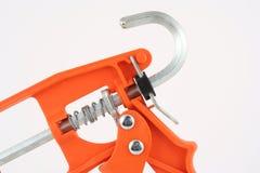 Pistola a spruzzo per presellatura arancione Fotografia Stock Libera da Diritti