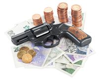 Pistola su soldi Fotografie Stock