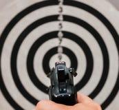 Pistola sull'obiettivo Fotografia Stock
