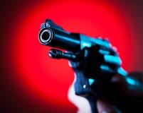 Pistola in una mano Fotografie Stock Libere da Diritti