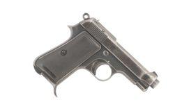 Pistola vieja en la derecha blanca del fondo Imagen de archivo libre de regalías