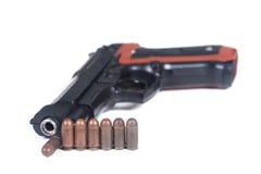 Pistola y munición Imágenes de archivo libres de regalías