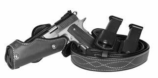 Pistola y pistolera Imagen de archivo libre de regalías