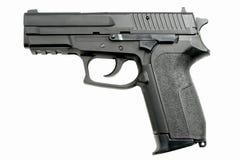 Pistole auf Weiß Stockfotografie