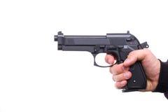 Pistole in der Hand lizenzfreie stockfotografie