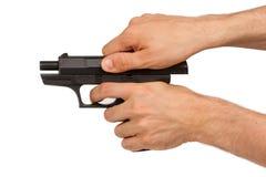 Pistole in der Hand, lokalisiert stockfoto
