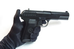 Pistole in der Hand - lokalisiert (weißer Hintergrund) Stockfoto