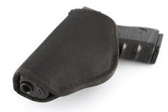 Pistole in der Tasche Stockfotografie