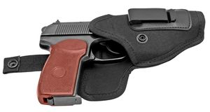 Pistole in einem Pistolenhalfter lizenzfreie stockfotos