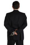Pistole hinter der Klage Lizenzfreies Stockbild