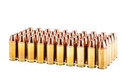 Pistolen-Kugeln über Weiß Lizenzfreie Stockfotografie