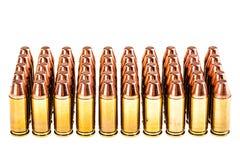 Pistolen-Kugeln auf Weiß Stockbild