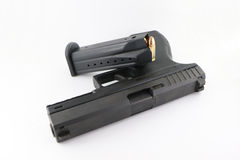 Pistolet avec une magazine Photos stock