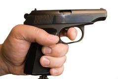 Pistolet dans une main image stock