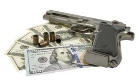 Pistolet i pieniądze Zdjęcie Stock