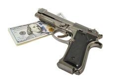 Pistolet i pieniądze Zdjęcia Royalty Free