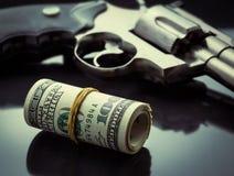 Pistolet i pieniądze Obrazy Royalty Free