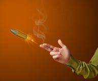 Pistolet kształtna męska ręka z pociskiem Zdjęcia Stock