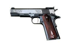 Pistolet sur le fond blanc images stock