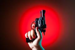 Pistolet w ręce Obrazy Stock