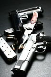 Pistols and blade. Pistols and blad, low key Royalty Free Stock Images