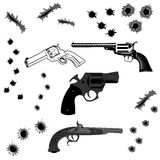 Pistols and bullet holes. Set of pistols and bullet holes in vector Royalty Free Stock Images