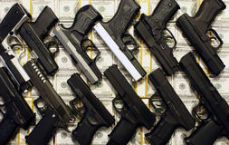Pistols and cash Stock Photography