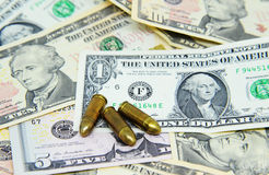 Pistols on dollar banknotes Royalty Free Stock Photos