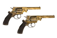 Pistols pair original decorated gold ornate revolvers Royalty Free Stock Photo