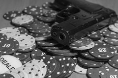 Pistols and poker chips on the game table Stock Photo