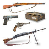 Pistols, rifles, machine guns, ammunition box. Stock Photos