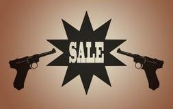 2 pistolvapen och försäljningstecken royaltyfri foto