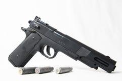Pistolvapen och kulor Arkivfoton