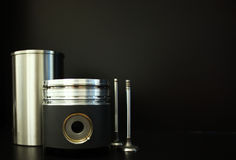 Piston with accesories. Liner, piston and valves isolated on black Royalty Free Stock Photography